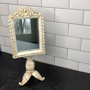 Vintage cream aged iron mirror on stand